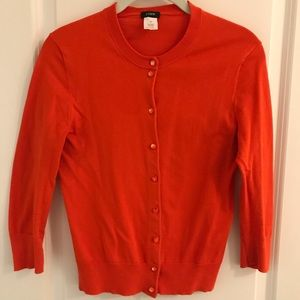JCrew Jackie cardigan in a bright red-orange color
